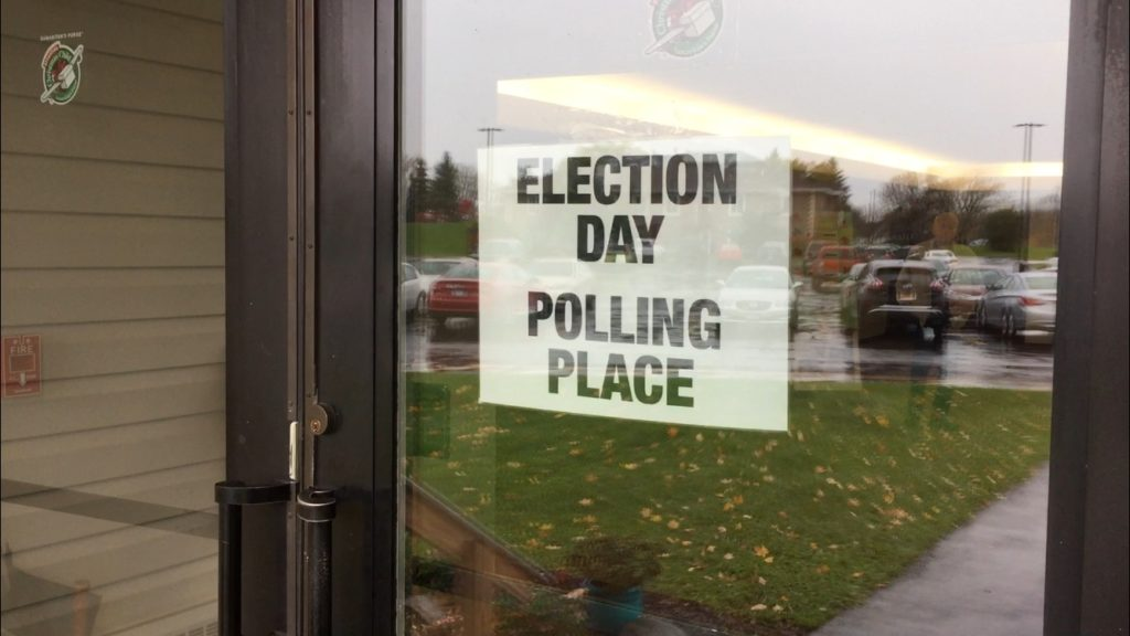 "Sign that says ""Election Day Polling Place"" on door."