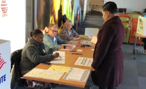 Dziko Boyd is signing in to vote in the election