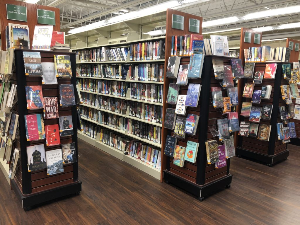 Shelves filled with books inside the Fayetteville Free Library.