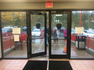 Voters leaving Camillus fire department in the rain.