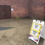 """A sign outside a polling place reading """"Voting Enter Here."""""""
