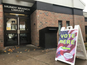 A sign in front of the entrance to the Mundy Branch Library shows voters where to go.