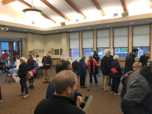 Skaneateles wait in line at a polling place. Some check in with election inspectors while others cast their ballots.