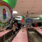 Balloons and tables set up for the 70th Anniversary of the Spaghetti Supper