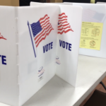 """White cardboard with """"Vote"""""""