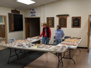 Two women working the Solvay-Geddes bake sale.