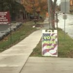A Vote Here sign on the sidewalk in front of the Erwin First United Methodist Church.