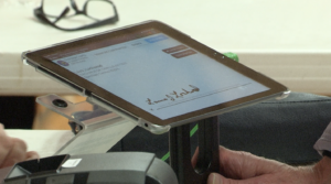 iPad with voter signature for digital poll book.