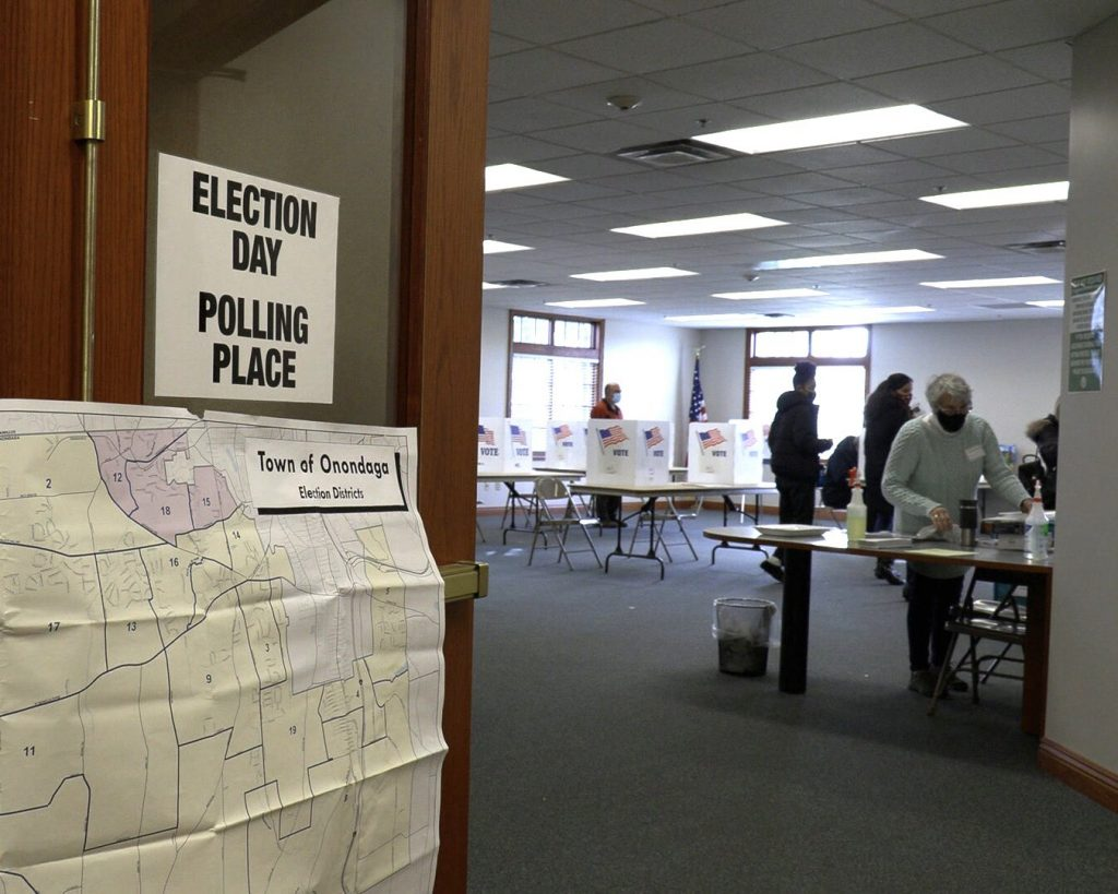 Pollworkers inside polling place at the Town of Onondaga Town Hall.