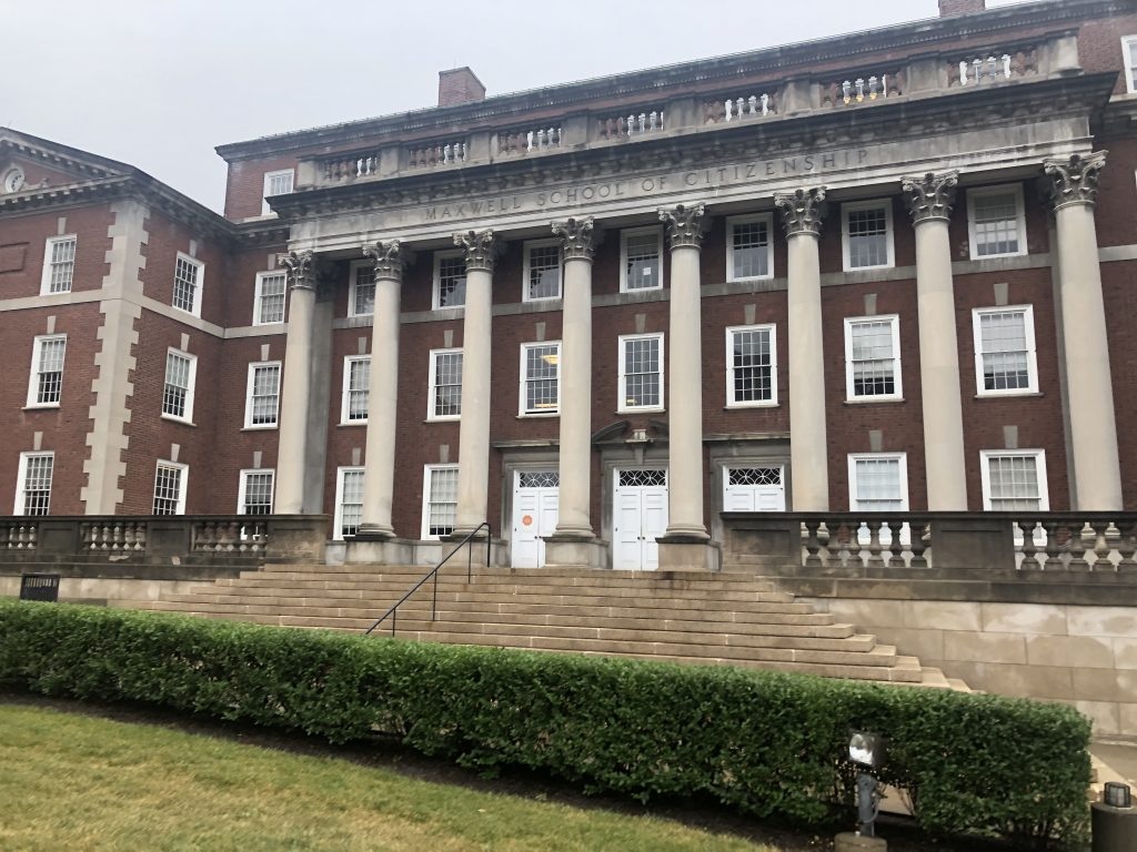 The outside of the Maxwell School of Citizenship and Public Affairs at Syracuse University.