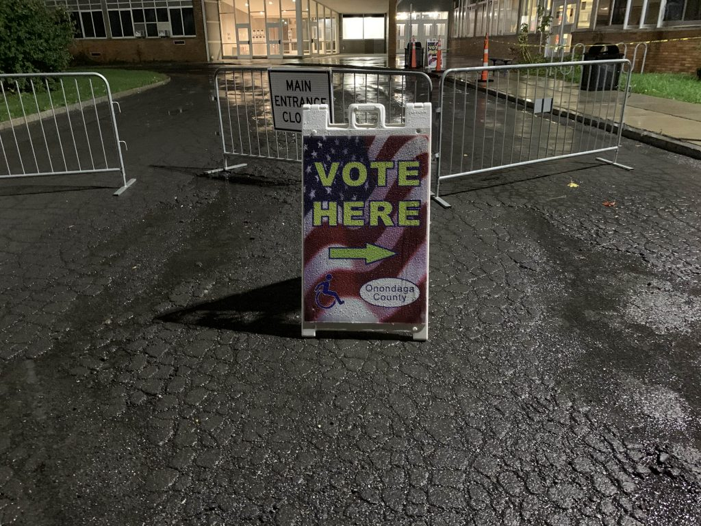 A Vote Here sign in front of Nottingham High School.