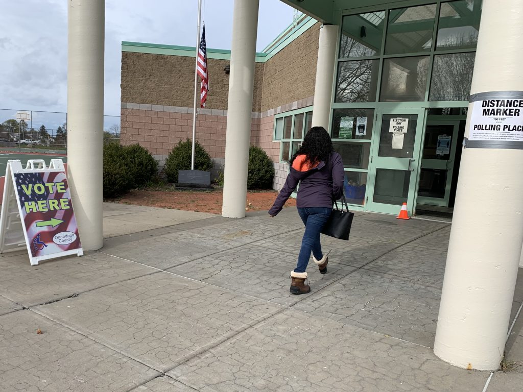 Woman walks into Armond Magnarelli Community Center to vote on Election Day.