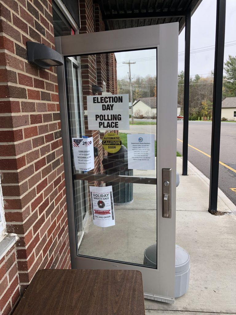 The door of the Van Buren Town Hall in Baldwinsville remains open to allow voters inside to cast their ballots.