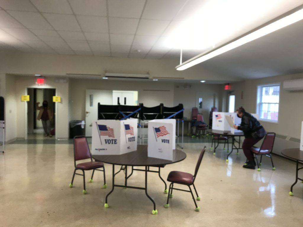 A voter drops off their ballot at the Jordan-Elbridge Community Center on November 3, 2020.