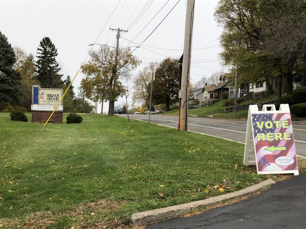 """Church sign and """"vote here"""" sign"""